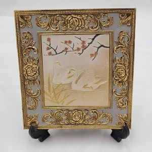 Vintage etched metal art with music box